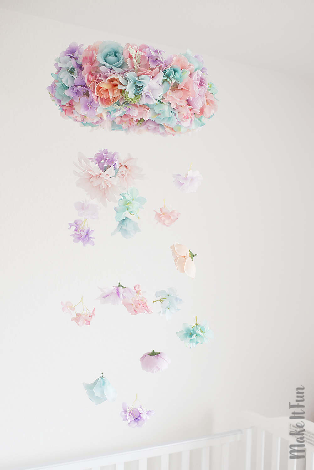 Easy hanging flower chandelier make it fun blog today i am sharing this lovely and whimsical diy hanging flower chandelier not only is this arrangement beautiful but it is so simple to put together and aloadofball Image collections